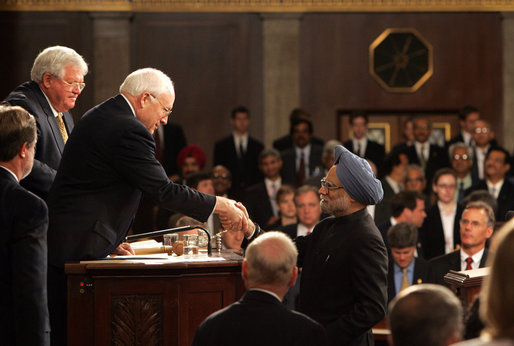 Vice President Dick Cheney shakes hands with Prime Minister Dr. Manmohan Singh of India upon the conclusion of his address to a Joint Meeting of Congress at the U.S. Capitol Tuesday, July 19, 2005. Also pictured at left is Speaker of the House Dennis Hastert. White House photo by David Bohrer