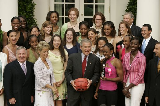 President George W. Bush and members of Baylor University's Lady Bears NCAA basketball team erupt in laughter Wednesday, July 20, 2005, during their Rose Garden visit at the White House. White House photo by Paul Morse