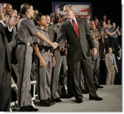 President George W. Bush meets Maryland Transportation Authority police officers, following his address to an audience Wednesday, July 20, 2005 at the Port of Baltimore in Baltimore, Md., where he encouraged renewal of Patriot Act provisions.  White House photo by Eric Draper