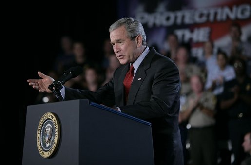 President George W. Bush gestures as he addresses an audience Wednesday, July 20, 2005 at the Port of Baltimore in Baltimore, Md., encouraging the renewal of provisions of the Patriot Act. White House photo by Eric Draper