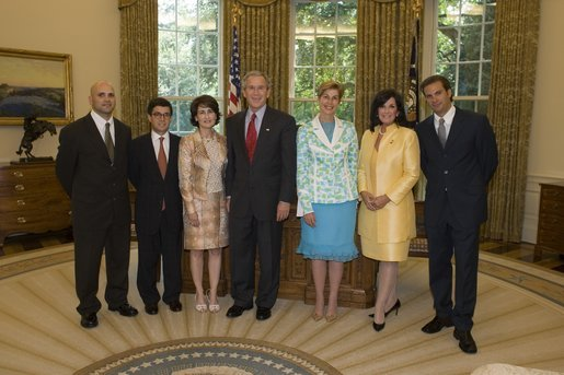 President George W. Bush welcomes representatives from the Colombian-American community and the government of Colombia into the Oval Office Wednesday, July 20, 2005, to commemorate Colombia's Independence Day. From left are: Augusto D'Avila, a veteran of Operation Iraqi Freedom; Colombia Ambassador Luis Alberto Moreno and his wife, Gabriela Fedres-Cordero; President Bush, Carolino Barco, Foreign Affairs Minister of Colombia; Gloria Haskins, R-S.C., and actor Paulo Benedeti. White House photo by Paul Morse