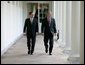 President George W. Bush walks along the Colonnade with Judge John G. Roberts, the President's nominee to the Supreme Court, during an early morning visit Wednesday, July 20, 2005, to the White House. White House photo by Eric Draper
