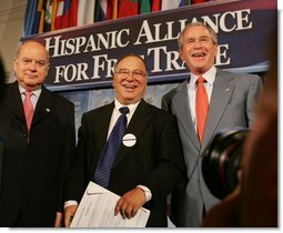 President George W. Bush meets with Chile's Jose Miguel Insulza, left, Secretary General, Organization of American States and Raul Yzaguirre, center, CEO of the National Council of La Raza, Thursday, July 21, 2005, following the President's address to the Hispanic Alliance for Free Trade in Washington.  White House photo by Eric Draper