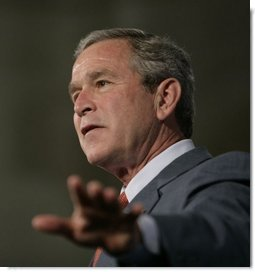 President George W. Bush gestures as he addresses the Hispanic Alliance for Free Trade, Thursday, July 21, 2005, at the Organization of American States in Washington. President Bush thanked the group for their support of CAFTA.  White House photo by Eric Draper