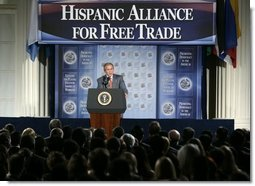 President George W. Bush addresses the Hispanic Alliance for Free Trade, Thursday, July 21, 2005, at the Organization of American States in Washington. President Bush thanked the group for their support of CAFTA.  White House photo by Eric Draper