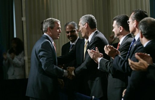 President George W. Bush greets audience members at the Hispanic Alliance for Free Trade, Thursday, July 21, 2005, at the Organization of American States in Washington. President Bush thanked the group for their support of CAFTA. White House photo by Eric Draper