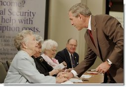 President George W. Bush meets with senior citizens, Friday, July 22, 2005, at the Wesley Woods Center in Atlanta, to talk about new options in Medicare.  White House photo by Paul Morse