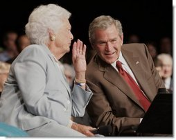 President George W. Bush talks to his mother Barbara Bush, Friday, July 22, 2005, during their appearance at a Conversation on Senior Security at the Boisfeuillet Jones Civic Center in Atlanta, to talk about Social Security and Medicare.  White House photo by Paul Morse