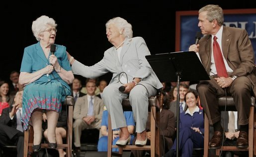 President George W. Bush and his mother Barbara Bush talk with Social Security recipient Frances Heverly, left, Friday, July 22, 2005, during a Conversation on Senior Security at the Boisfeuillet Jones Civic Center in Atlanta, to talk about Social Security and Medicare. White House photo by Paul Morse