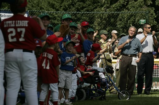 President George W. Bush welcomes players and their family members from the West University Little League Challengers from Houston, Texas, and the District 12 Little League Challengers from Williamsport, Pa., Sunday, July 24, 2005, at a Tee Ball game on the South Lawn of the White House. White House photo by Carolyn Drake