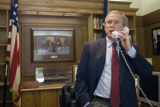 President George W. Bush offers his congratulations to Tour de France winner Lance Armstrong over the phone from this office at Camp David, Maryland. White House photo by Paul Morse