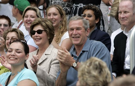 President George W. Bush and Mrs. Laura Bush cheers on players during a Tee Ball game on the South Lawn of the White House between the District 12 Little League Challengers from Williamsport, PA and the West University Little League Challengers from Houston, Texas on Sunday July 24, 2005. White House photo by Paul Morse