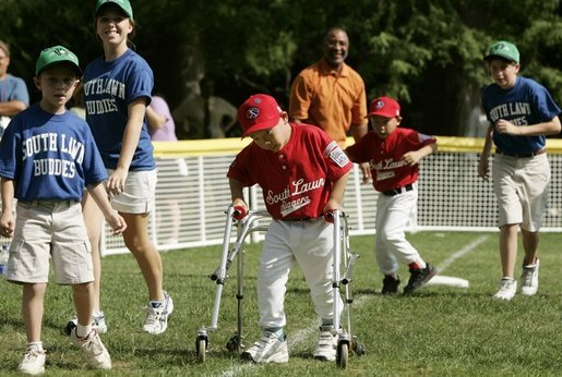 A player from the West University Little League Challengers from Houston, Texas, heads for homeplate to score a run, Sunday, July 24, 2005, during a Tee Ball game on the South Lawn of the White House. White House photo by Paul Morse