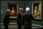 "President and Mrs. Bush receive a tour of the Gilbert Stuart Exhibition at the National Gallery of Art, from gallery director Earl "" Rusty"" Powell III, Monday, July 25, 2005 in Washington. White House photo by Krisanne Johnson"