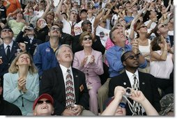 Laura Bush applauds as she folllows the launch of the Space Shuttle Discovery, Tuesday, July 26, 2005, at the Kennedy Space Center in Cape Canaveral, Florida. Mrs. Bush is joined by Florida Governor Jeb Bush, right, and NASA Astronaut Scott Altman, left.  White House photo by Krisanne Johnson