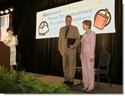 Laura Bush and her brother-in-law Florida Gov. Jeb Bush are applauded upon their arrival at the Teen Trendsetters Reading Mentors 2005 Annual Summit, July 26, 2005 at the Wyndham Orlando Resort in Orlando, Florida.  White House photo by Krisanne Johnson