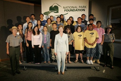 Laura Bush poses for a photo at the Junior Ranger swearing-in ceremony, July 27, 2005, at the Minnesota Science Museum in St. Paul, Minnesota. White House photo by Krisanne Johnson