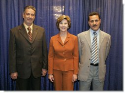 Laura Bush visits with Talib Aziz M. Zaini, Minister of Youth and Sports for Iraq, left, and Abbas Kadim Ibrahim, Director General, Ministry of Youth and Sports for Iraq, at the National Youth Summit in Washington, D.C., Friday, July 29, 2005. The Iraqi officials attended the summit to increase their understanding of youth development. White House photo by Krisanne Johnson