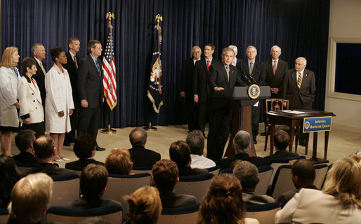President George W. Bush, seen with members of the U.S. Senate and patient advocates, addresses an audience following his sigining of the Patient Safety and Quality Improvement Act of 2005, at a ceremony Friday, July 29, 2005 in the Eisenhower Executive Office Building in Washington, D.C. White House photo by Krisanne Johnson