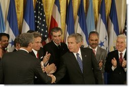 President George W. Bush shakes hands with legislators, administration officials and guests, Tuesday, Aug. 2. 2005 in the East room of the White House, after the signing ceremony for the CAFTA Implementation Act.  White House photo by Krisanne Johnson