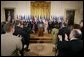 President George W. Bush acknowledges the applause of legislators, administration officials and guests, Tuesday, Aug. 2. 2005 in the East room of the White House, at the signing ceremony for the CAFTA Implementation Act. White House photo by Paul Morse