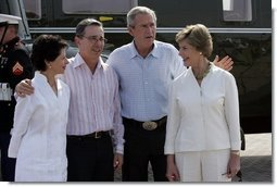 President George W. Bush and Colombian President Alvaro Uribe pose with their wives, U.S. first lady Laura Bush (R) and Colombia first lady Lina Moreno at the President's Central Texas ranch in Crawford, Texas, on August 4, 2005.  White House photo by Paul Morse
