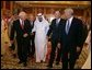 Vice President Dick Cheney walks with newly crowned King Abdullah, former President George H. W. Bush, and former Secretary of State Colin Powell during a retreat at King Abdullah's Farm in Riyadh, Saudi Arabia Friday, August 5, 2005, following the death of Abdullah's half-brother King Fahd who passed away August 1, 2005. White House photo by David Bohrer