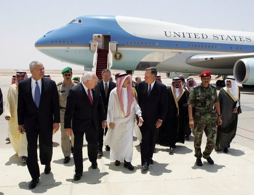 Vice President Dick Cheney, former Secretary of State Colin Powell, and former President George H.W. Bush are escorted from the plane by members of the Saudi delegation before meeting with the newly crowned King Abdullah of Saudi Arabia Friday, August 05, 2005. Vice President Dick Cheney led a delegation to pay respects following the recent death of King Fahd. White House photo by David Bohrer