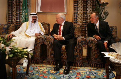 Vice President Dick Cheney and former President George H.W. Bush talk with newly crowned King Abdullah of Saudi Arabia, following the recent death of King Fahd, Friday, August 05, 2005. The vice president led a delegation to pay respects and offer condolences. White House photo by David Bohrer