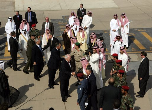 Vice President Dick Cheney, former President George H.W. Bush and former Secretary of State Colin Powell shake hands before their departure back to the United States upon the conclusion of their meeting with King Abdullah following the recent death of King Fahd, Friday, August 05, 2005. Vice President Dick Cheney led a delegation to pay respects following the recent death of King Fahd. White House photo by David Bohrer