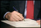 President George W. Bush signs H.R. 6, The Energy Policy Act of 2005 at Sandia National Laboratory in Albuquerque, New Mexico, Monday, Aug. 8, 2005. White House photo by Eric Draper