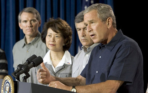 President George W. Bush addresses a news conference, Tuesday, Aug. 9, 2005 at the Bush Ranch in Crawford, Texas, following a meeting to discuss the strength of the U.S. economy. At left are economic policy advisors U.S. Trade Representative Rob Portman; U.S. Secretary of Labor Elaine Chao and U.S. Secretary of Agriculture Mike Johanns. White House photo by Paul Morse