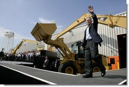 President George W. Bush acknowledges the applause of the crowd as he arrives to sign the Transportation Equity Act, at the Caterpillar facility in Montgomery, Ill., Wednesday, Aug. 10, 2005. White House photo by Eric Draper