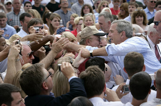 President George W. Bush greets the crowd after signing the Transportation Equity Act, at the Caterpillar facility in Montgomery, Ill., Wednesday, Aug. 10, 2005. White House photo by Eric Draper