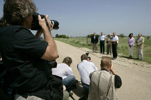 President George W. Bush talks with the media Thursday, Aug. 11, 2005, at the Bush Ranch in Crawford, Texas, after meeting with the Defense and Foreign Policy teams. White House photo by Eric Draper