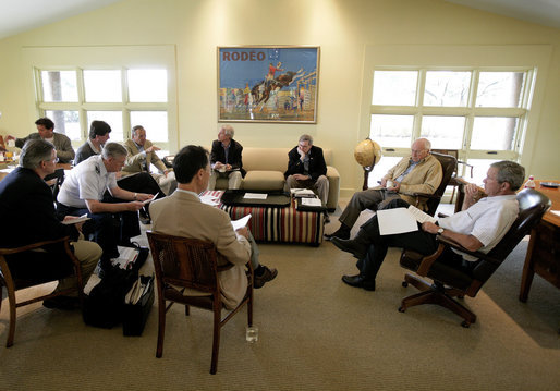 President George W. Bush and Vice President Dick Cheney listen Thursday, Aug. 11, 2005, to Secretary of Defense Donald Rumsfeld during a meeting with the Defense Policy and Program teams at the Bush Ranch in Crawford, Texas. White House photo by Eric Draper
