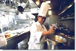 "Chef Cristeta ""Cris"" Comerford prepares a meal inside the White House kitchen in this July 17, 2002 photo. Mrs. Laura Bush announced on August 14, 2005 that Comerford has been named the White House Executive Chef. Comerford is the first woman to serve in the job.  White House photo by Tina Hager"