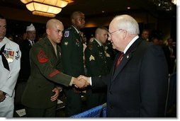 Vice President Dick Cheney shakes the hand of Sgt. Justin Genovese, US Marine Corps, who was wounded in battle in Iraq, August 4, 2004. The vice president spoke to he and other the attendees at the 73rd National Convention of the Military Order of the Purple Heart in Springfield, Missourri, Thursday, August 18, 2005. The organization was formed in 1932 for the protection and mutual interest of all who have, as a result of being wounded in combat, recieved the Purple Heart.  White House photo by David Bohrer