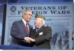 President George W. Bush talks with Veterans of Foreign Wars Commander-in-chief John Furgess during his visit to the VFW national convention in Salt Lake City, Utah, August 22, 2005. White House photo by Paul Morse
