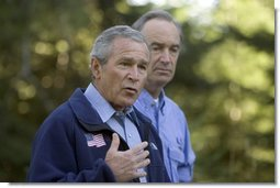Standing with Idaho Governor Dirk Kempthorne, President George W. Bush talks with the press in Donnelly, Idaho, Tuesday, Aug. 23, 2005.  White House photo by Paul Morse