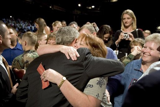 The mother of four sons currently deployed to Iraq, Tammy Pruett, is embraced by President George W. Bush following his speech at Idaho Center Arena, Wednesday, Aug. 24, 2005 in Nampa, Idaho, honoring the service of National Guard and Reserve troops serving in Afghanistan and Iraq. White House photo by Paul Morse