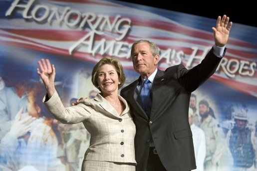 President George W. Bush and Laura Bush wave to the crowd of military families, Wednesday, Aug. 24, 2005 at the Idaho Center Arena in Nampa, Idaho, following the President's speech honoring the service of National Guard and Reserve forces serving in Afghanistan and Iraq. White House photo by Paul Morse