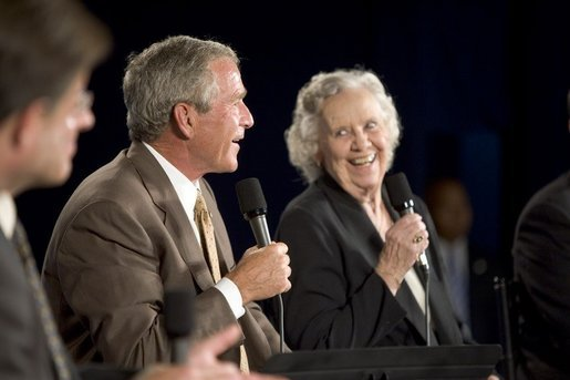 President George W. Bush shares a laugh with Myrtle Jones during a Conversation on Medicare Monday, Aug. 29, 2005, at the James L. Brulte Senior Center in Rancho Cucamonga, Calif. White House photo by Paul Morse