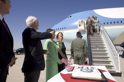 President George W. Bush and Laura Bush are greeted by Arizona Senator John McCain after arriving Monday, Aug. 29, 2005, at Luke Air Force Base near Phoenix. The President later addressed 400 guests at the Pueblo El Mirage RV Resort and Country Club, highlighting benefits of the new Medicare Prescription Drug coverage. White House photo by Paul Morse