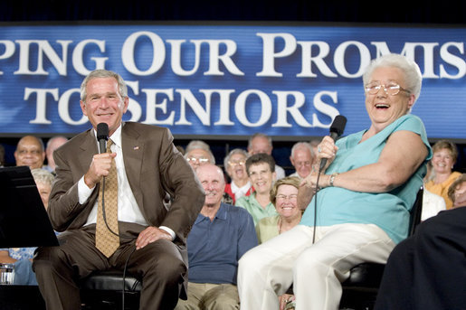 President George W. Bush shares a laugh with 82-year-old Margaret Cantrell of Scottsdale, during a Conversation on Medicare Monday, Aug. 29, 2005, at the Pueblo El Mirage RV Resort and Country Club in nearby El Mirage, Ariz. White House photo by Paul Morse