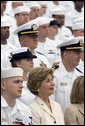 Laura Bush listens to President George W. Bush speak during a ceremony to commemorate the 60th anniversary of V-J Day at the Naval Air Station in San Diego, Calif., August 30, 2005. White House photo by Paul Morse
