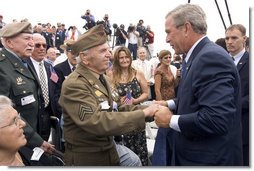 President George W. Bush greets a veteran after delivering remarks to commemorate the 60th anniversary of V-J Day at the Naval Air Station in San Diego, Calif., August 30, 2005. White House photo by Paul Morse