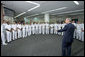 President George W. Bush talks with health care providers at the Naval Medical Center during a visit to commemorate the 60th anniversary of V-J Day at the Naval Air Station in San Diego, Calif., August 30, 2005. White House photo by Paul Morse
