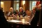 Flanked by Michael Chertoff, Secretary of Homeland Security, left, and Secretary of Defense Donald Rumsfeld, President George W. Bush meets with members of the White House Task Force on Hurricane Katrina Recovery Wednesday, Aug. 31, 2005, in the Cabinet Room of the White House. White House photo by Krisanne Johnson