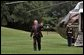 President George W. Bush waves upon arriving at the South Lawn of the White House Wednesday, August 31, 2005. This afternoon President Bush meets with his task force regarding Hurricane Katrina. White House photo by Krisanne Johnson